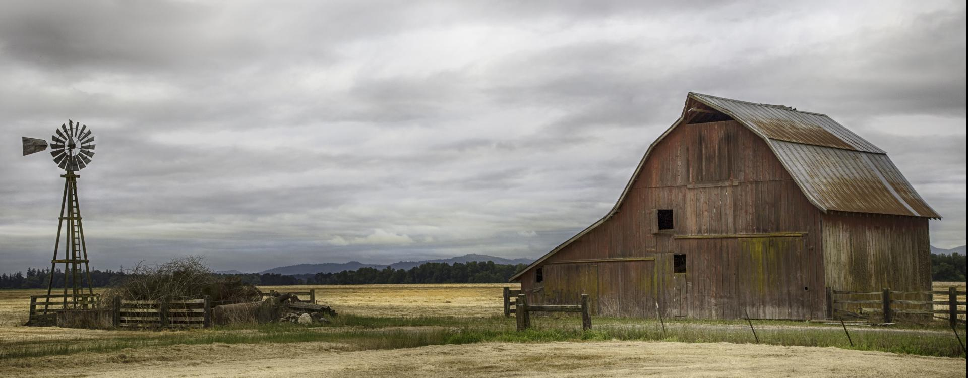 old barn in middle of a field